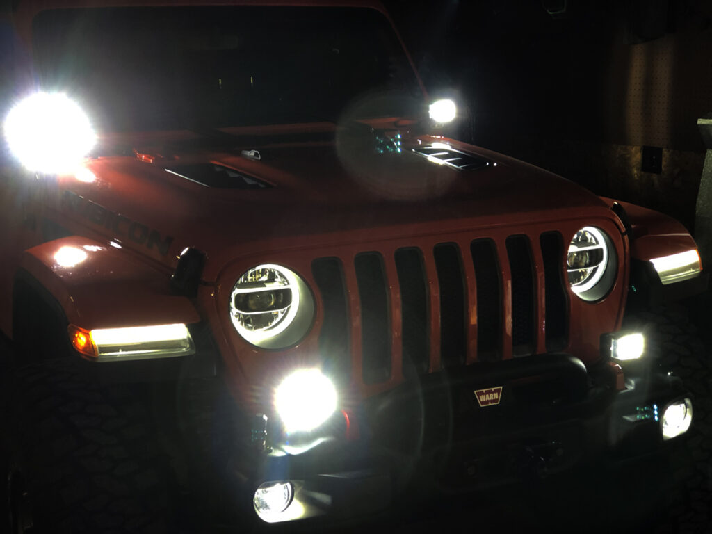 2018 Jeep Wrangler Rubicon with aftermarket LED off-road and accent lights.