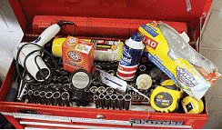 Common household remedies for automotive repair tasks include a hair dryer, a fish scale, paper clips, a vanity mirror, baking soda, freezer bags, a coat hanger, and a turkey baster.